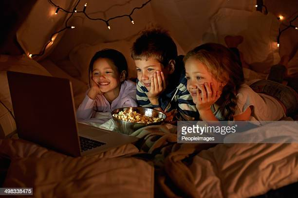 movie time in the blanket fort - film stock pictures, royalty-free photos & images