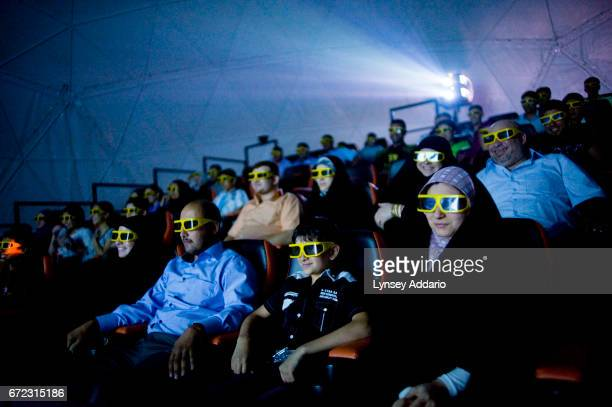 Moviegoers at Baghdad's first socalled 4D cinema get an extra thrill from shaking seats and wind machines during a 3D scifi film During the worst...