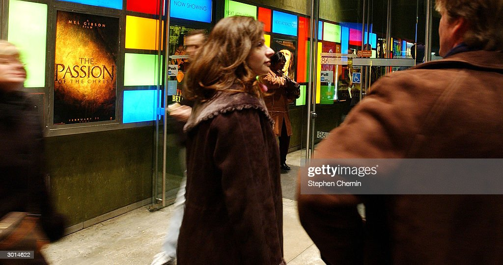 Movie-goers wait in line in front of a advertisement for Mel Gibson's The Passion of the Christ at a theater February 25, 2004 in New York CIty. 'The Passion of the Christ' opened in cinemas across the country as many Jewish groups pinned it as anti-Semitic.