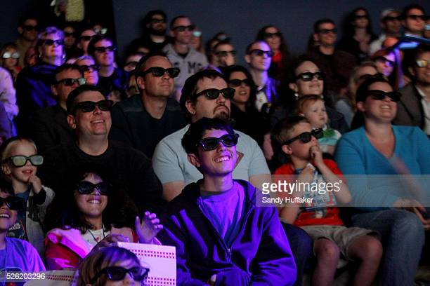 Movie-goers watch a premiere of Clutch Powers while waring 3-D glasses at Legoland, California in Carlsbad, California. Movies in 3-D are becoming...