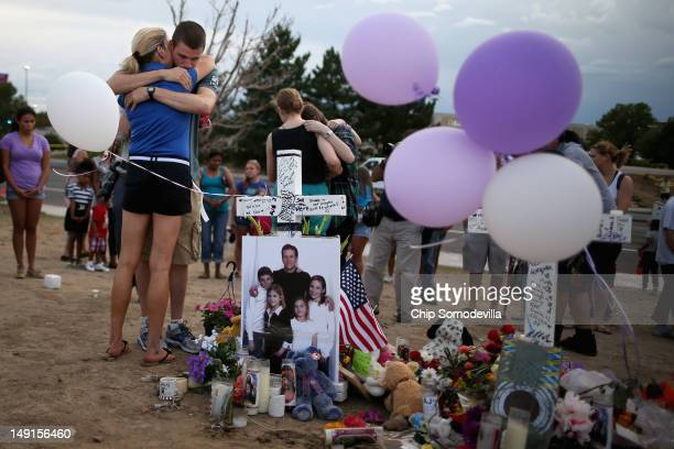 Movietheatershootingvictim Gordon Cowden's family gather at the makeshift memorial built across the street from the Century 16 theater July 23 2012...