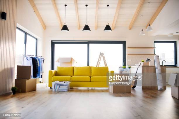 moving boxes in modern kitchen and living room in a new home. - new home stock pictures, royalty-free photos & images