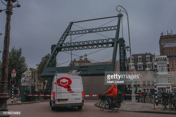 moving bridge over canal in amsterdam in raised position - mark's stock pictures, royalty-free photos & images