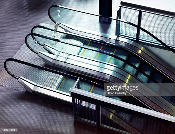 moving escalators - crausby stock pictures, royalty-free photos & images