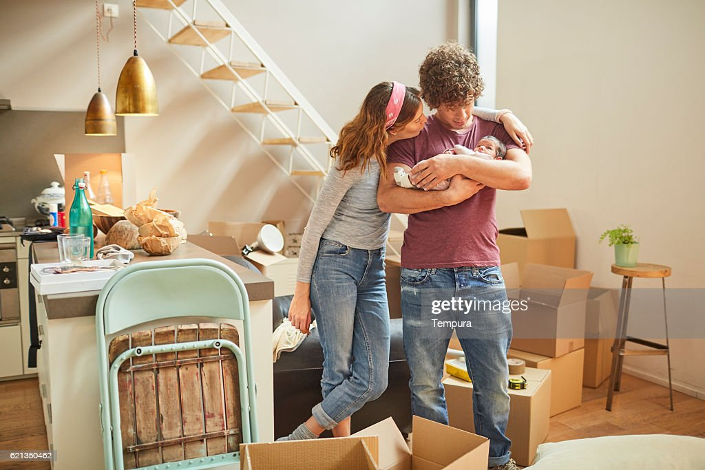 Moving home new beginnings. Couple with baby. : Stock Photo