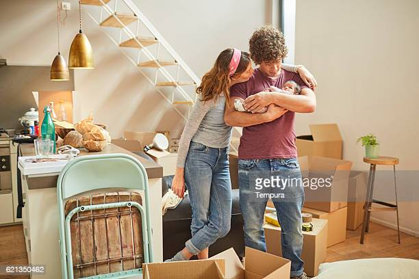 moving home new beginnings. couple with baby. - newlywed stock pictures, royalty-free photos & images