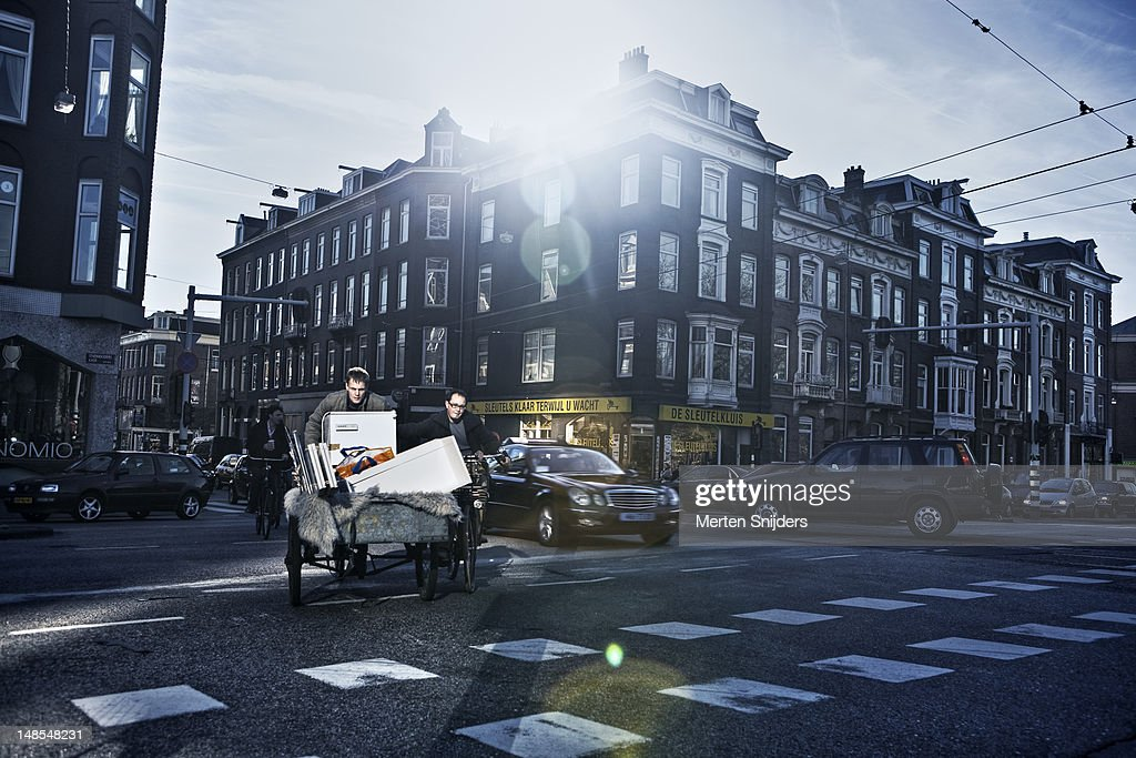Moving houses with Dutch bakfiets (cargo bike). : Stock Photo