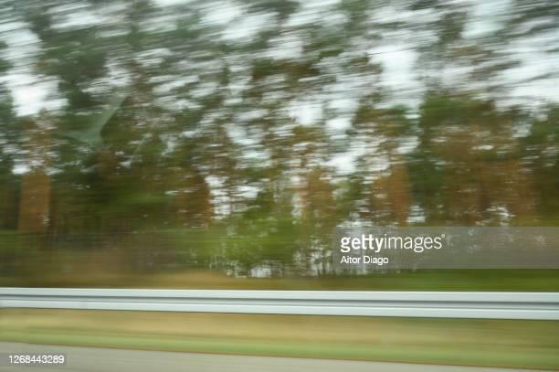 moving image of the railing of a highway in a forest area - vedação de corrimão imagens e fotografias de stock