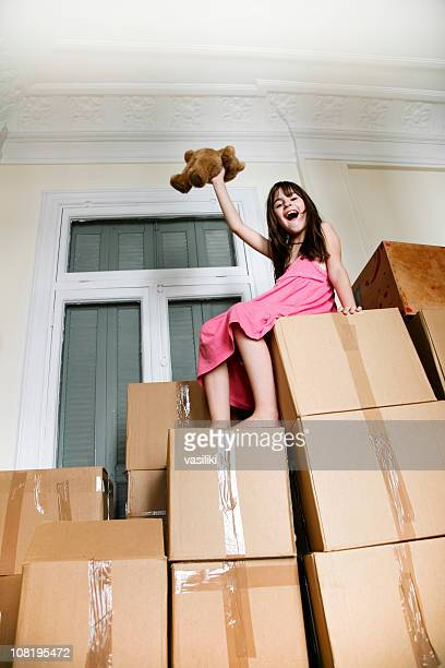 moving in a new house - girl mound stock pictures, royalty-free photos & images
