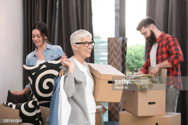 moving into an apartment - mother in law stock pictures, royalty-free photos & images
