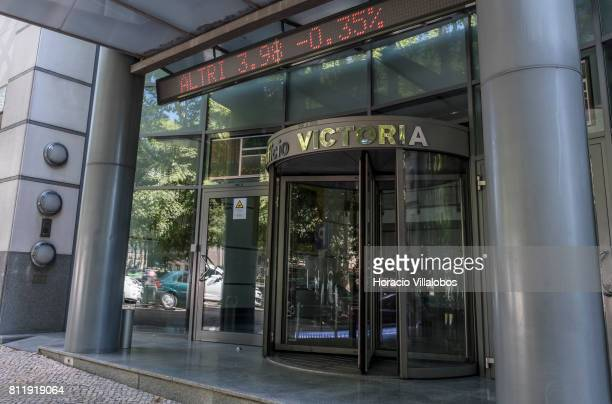 Moving light board shows stock exchange information and companies' shares values at the main entrance of Edificio Victoria site of Euronext in...