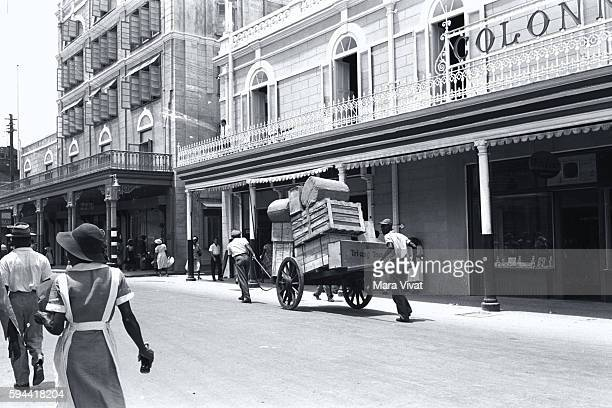 Moving Loaded Pushcart Down City Street Barbados