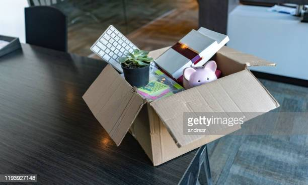 moving office and packing belongings in a box - quitting a job stock pictures, royalty-free photos & images