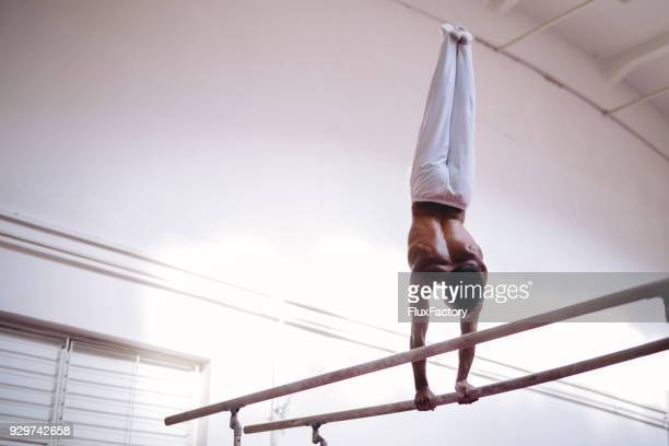 moving on parallel bars - gymnastics stock pictures, royalty-free photos & images