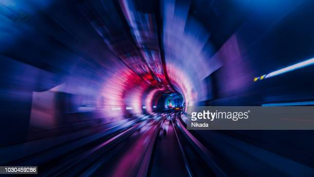 moving through a illuminated tunnel - projection stock pictures, royalty-free photos & images