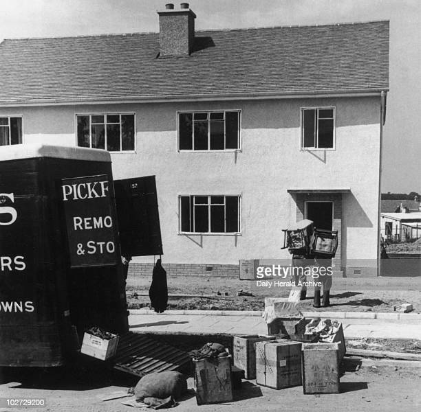 'Moving to the new house East Kilbride Glasgow' 15 June 1949 'Furniture vans are busy installing the first of the new residents to move into the new...