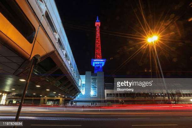 Moving traffic leaves light trials beneath the Radio Tower which has been illuminated in red and blue to mark the day the UK leaves the European...