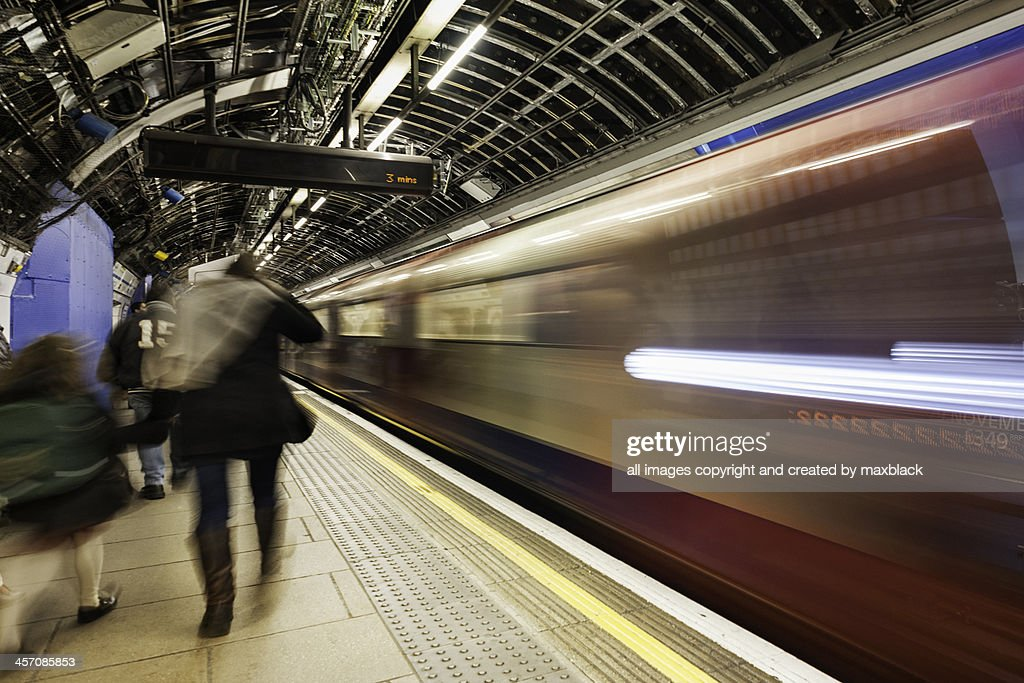 Moving trains and moving people : Stock Photo