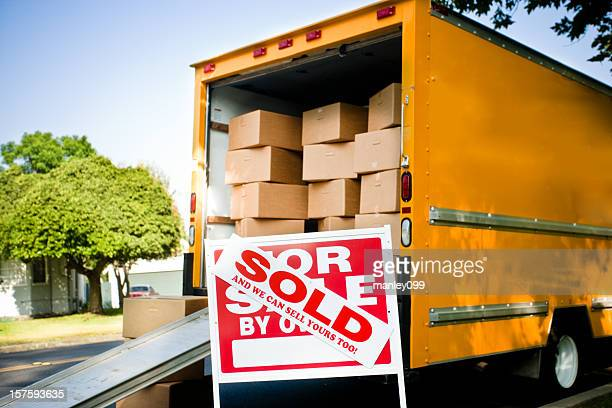 moving truck and sold sign