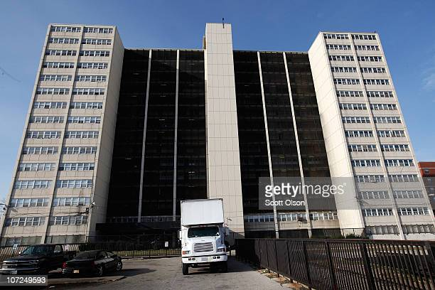 A moving truck is parked in front of 1230 N Burling St the last occupied highrise in the CabriniGreen public housing complex on December 2 2010 in...