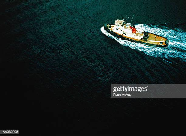 moving tugboat, aerial view - tugboat stock photos and pictures