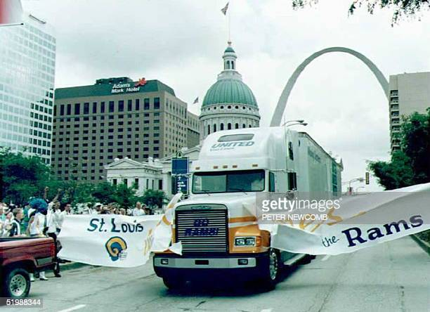 A moving van part of a convoy of trucks carrying the equipment of the newly transplanted St Louis Rams football team breaks through a welcoming...