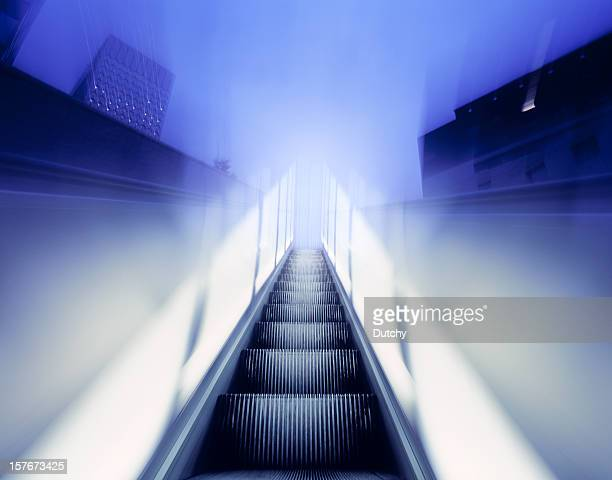 Moving walkway in business district.