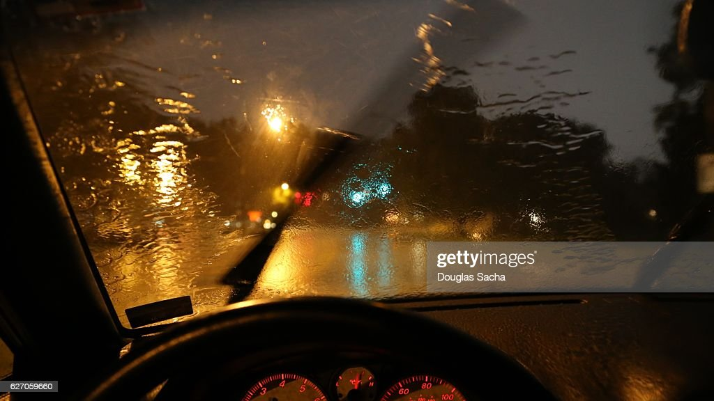 Moving windshield wiper view of a moving vehicle : Stock Photo