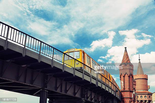 moving yellow train in kreuzberg u-bahn in berlin - kreuzberg stock photos and pictures