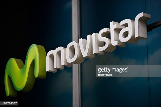 A Movistar logo sits on display outside a Telefonica SA phone store in Barcelona Spain on Tuesday March 26 2013 Telefonica seeking to reduce net debt...
