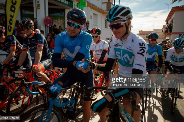 Movistar Spanish cyclist Mikel Landa shakes hand with Team Sky's British cyclist Christopher Froome prior to the first stage of the 'Ruta del Sol'...
