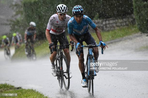 Movistar Team rider Colombia's Nairo Quintana attacks past Team Ineos rider Poland's Michal Kwiatkowski during the seventh stage of the 71st edition...