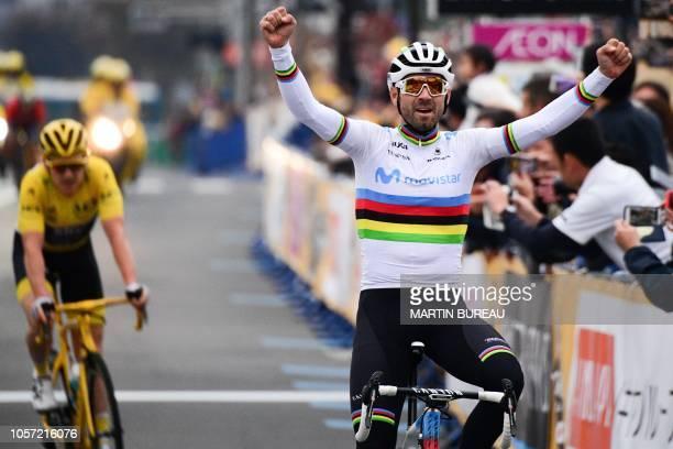 Movistar team Spanish rider Alejandro Valverde crosses the finish line ahead of the 2018 Tour de France winner British Geraint Thomas during the Le...