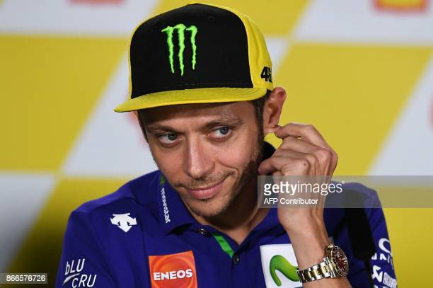 Movistar Yamaha Italian rider Valentino Rossi gestures during a press conference ahead of the Malaysia MotoGP at the Sepang International circuit in...