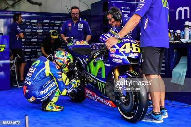 Movistar Yamaha Italian rider Valentino Rossi inspects his machine before leaving the pit lane during the first practice session of the Malaysia...