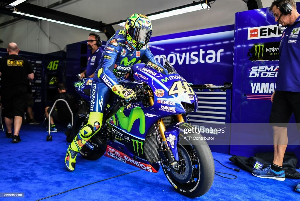 Movistar Yamaha Italian rider Valentino Rossi leaves the team pit during the first practice session of the Malaysia MotoGP at the Sepang International circuit in Sepang on October 27, 2017. /