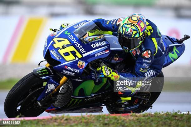 Movistar Yamaha Italian rider Valentino Rossi negotiates a corner during the second practice session of the Malaysia MotoGP at the Sepang...