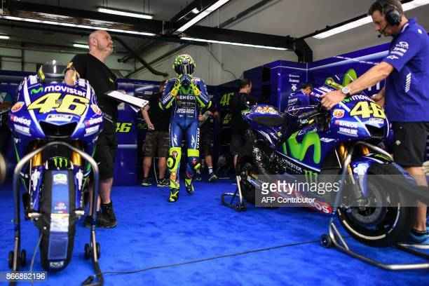 Movistar Yamaha Italian rider Valentino Rossi walks towards his bike during the first practice session of the Malaysia MotoGP at the Sepang...