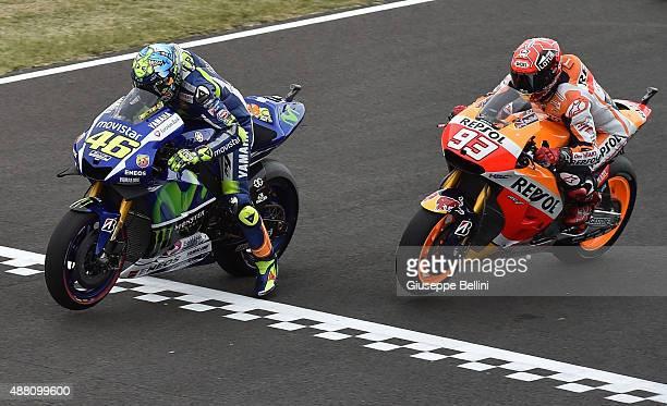 Movistar Yamaha Moto GP's Italian rider Valentino Rossi and Repsol Honda Team Moto GP's Spanish rider Marc Marquez at the start of the Moto GP World...