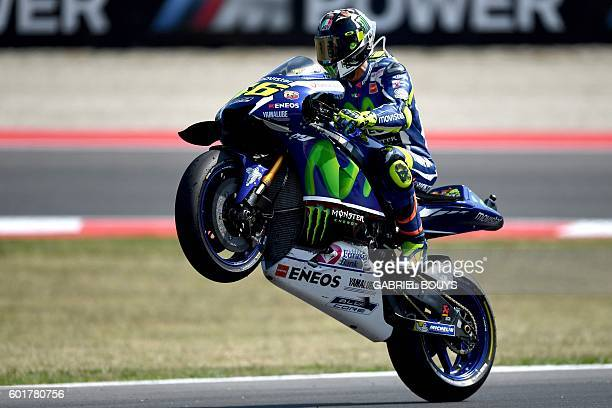 Movistar Yamaha Moto GP's Italian rider Valentino Rossi rides his bike after the qualifying session at the Marco Simoncelli Circuit of the San Marino...