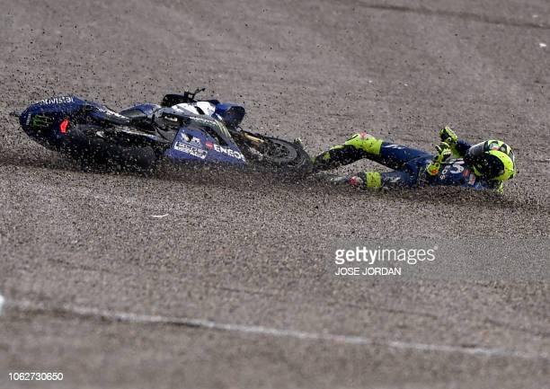 Movistar Yamaha MotoGP Italian rider Valentino Rossi falls during the third MotoGP free practice session of the Valencia Grand Prix at the Ricardo...