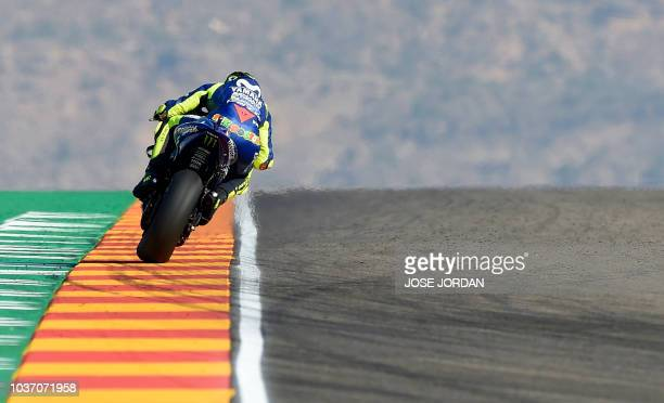 TOPSHOT Movistar Yamaha MotoGP Italian rider Valentino Rossi rides during the MotoGP first free practice of the Aragon Grand Prix at the Motorland...
