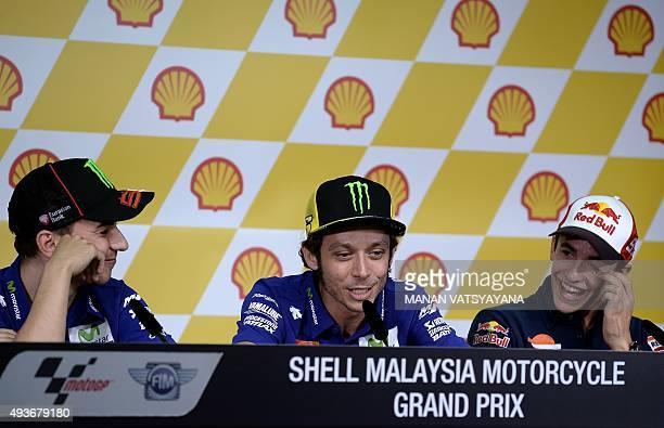 Movistar Yamaha MotoGP rider Jorge Lorenzo of Spain and Repsol Honda Team rider Marc Marquez of Spain gesture as Movistar Yamaha MotoGP rider...