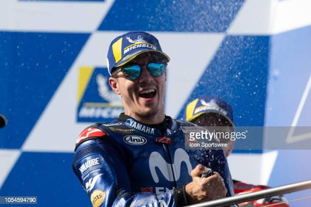 Movistar Yamaha MotoGP rider Maverick Vinales on the podium as the winner sprays the champagne at The 2018 Australian MotoGP on October 28 at The...