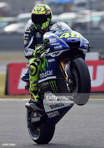 Movistar Yamaha MotoGP rider Valentino Rossi of Italy performs a wheelie during the second MotoGPclass free practice session of the MotoGP Japanese...