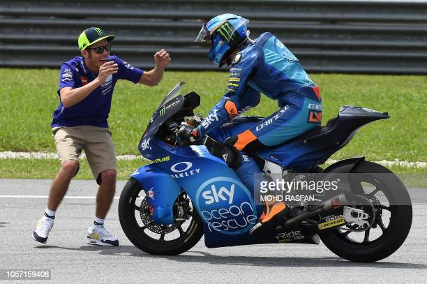 TOPSHOT Movistar Yamaha MotoGP team Italian rider Valentino Rossi celebrates with SKY Racing Team VR46s Italian rider Luca Marini after the Moto2...