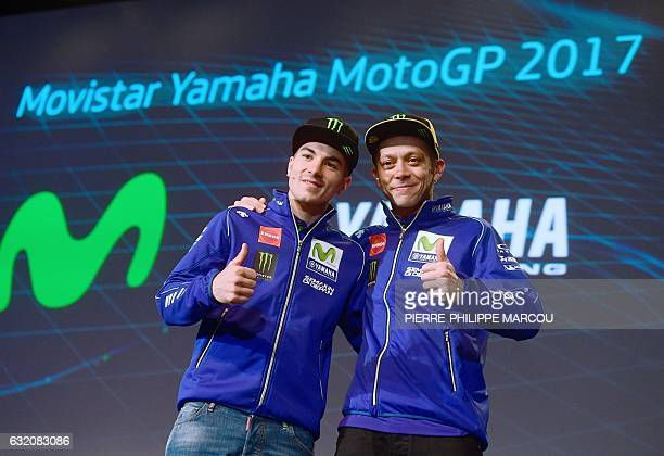 Movistar Yamaha MotoGP Team's riders Spanish Maverick Vinales and Italian Valentino Rossi pose in Madrid on January 19 2017 / AFP / PIERREPHILIPPE...