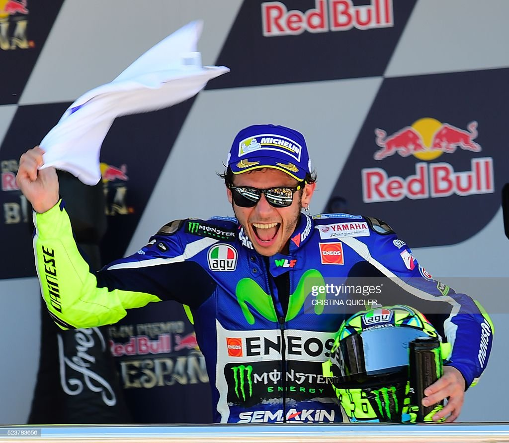 Movistar Yamaha MotoGP's Italian rider Valentino Rossi celebrates his victory on the podium of the MotoGP race of the Spanish Moto Grand Prix at the Jerez racetrack in Jerez de la Frontera on April 24, 2016. / AFP / CRISTINA