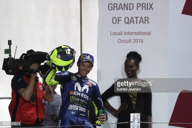 Movistar Yamaha MotoGP's Italian rider Valentino Rossi celebrates on the podium following the 2018 Qatar Moto GP Grand Prix at the Losail...