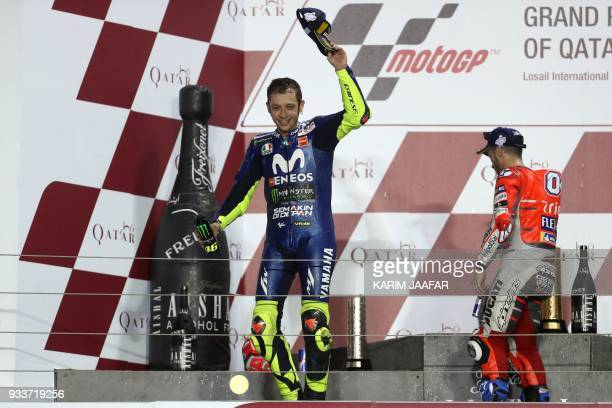 Movistar Yamaha MotoGP's Italian rider Valentino Rossi celebrates following the 2018 Qatar Moto GP Grand Prix at the Losail International Circuit in...